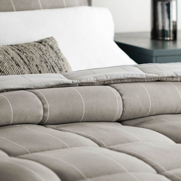closeup of the Malouf Chambray Comforter Set in Birch
