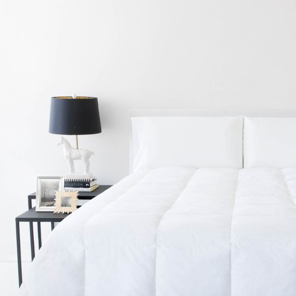 Malouf Woven ™ Down Blend Comforter on bed