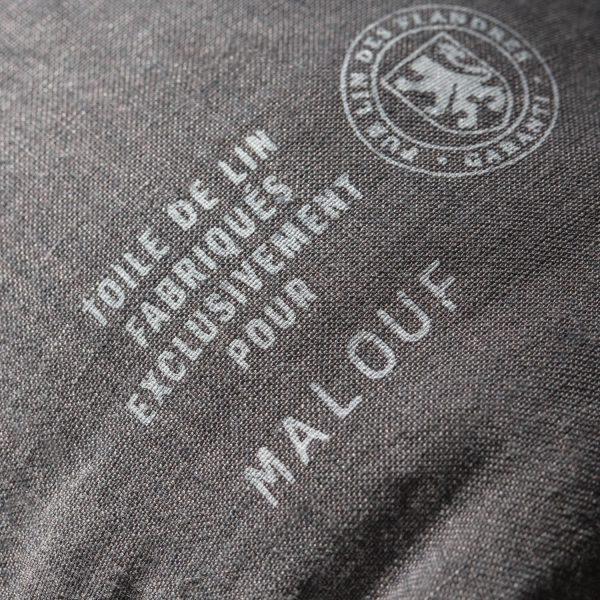 closeup of stamp on packaging - Toile de lin fabriques exclusivement pour Malouf