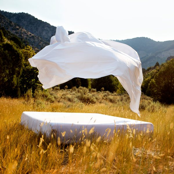 Italian Artisan sheets flying in the wind outdoors in the mountains
