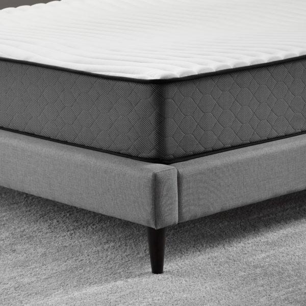 "corner view of Neeva 10"" Hybrid Mattress - Firm - in shown in a bedroom"