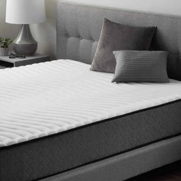 """side view of Neeva 10"""" Hybrid Mattress - Firm - in shown in a bedroom"""