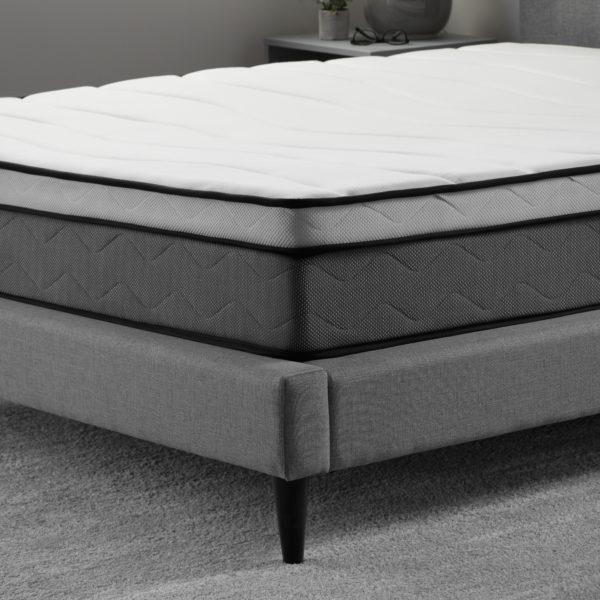 "corner view of Neeva 10"" Hybrid Mattress - Plush - in shown in a bedroom"