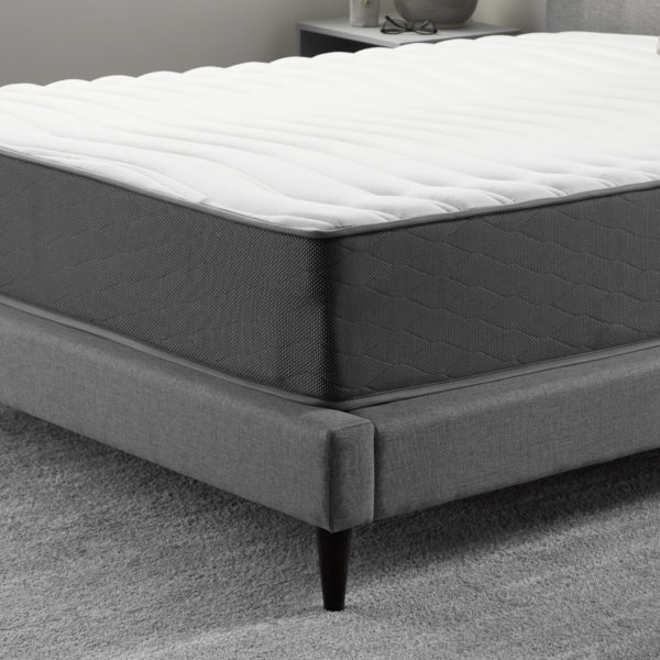 "corner view of Neeva 12"" Hybrid Mattress - Firm - in shown in a bedroom"