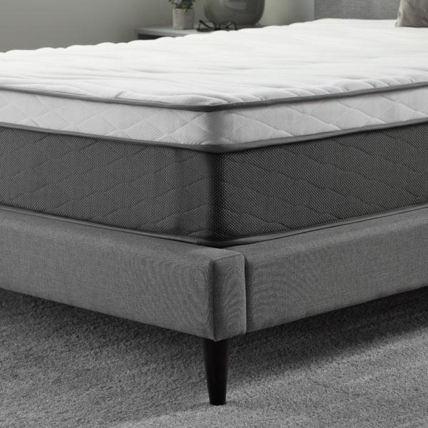 "corner view of Neeva 12"" Hybrid Mattress - Plush - in shown in a bedroom"